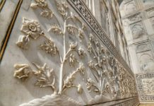 The floral designs on the walls of Taj Mahal.