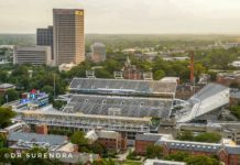 *My Picture of the day* The oldest college football stadium in US - built in 1913, capacity 55000, home of the Georgia Tech University team. The tall building in the background is the World headquarters of Coca-cola, seen at Atlanta Georgia. ***** *Dr.Surendra* — in Atlanta, Georgia